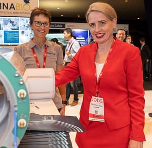 The Hon. Kate Jones MP, checking out Magnetica's compact MRI products with Sara, Product Manager