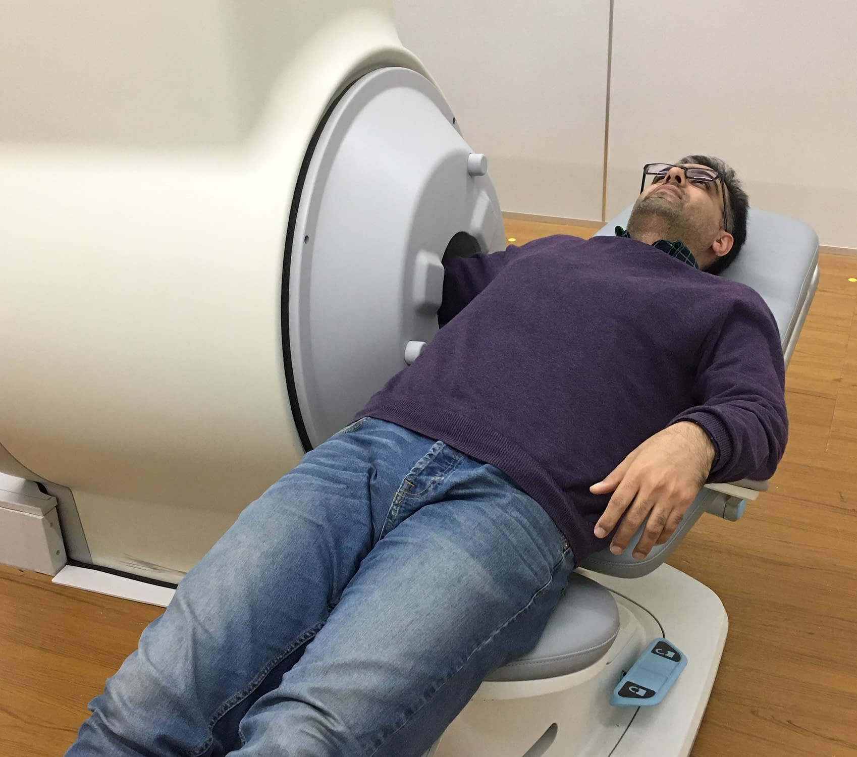 Compact MRI Systems for extremities - The patient getting an MRI scan of the arm.